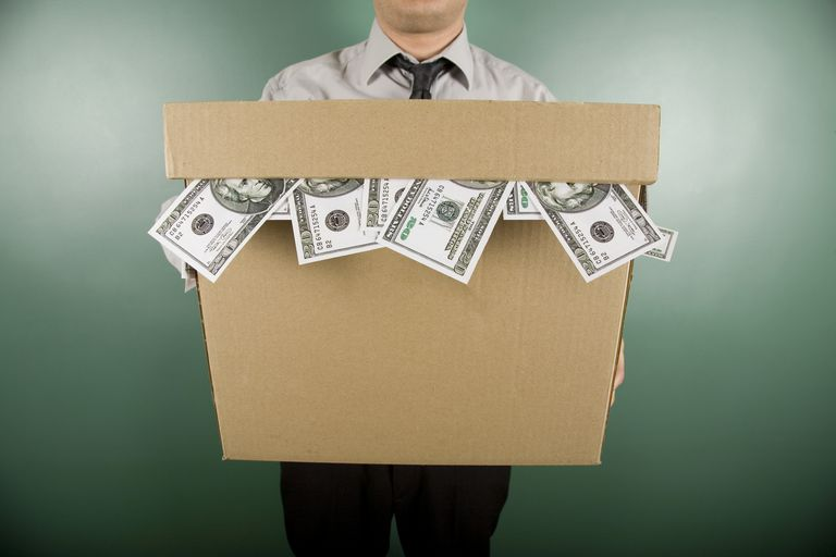 Man holding a storage box full of salary deferral contributions.