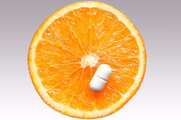 Orange and vitamin C pill