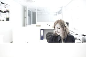 Woman in a cubicle