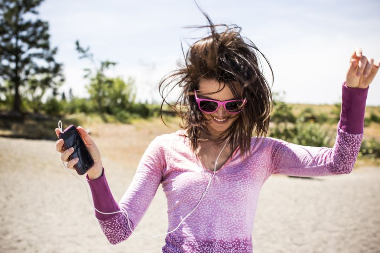A woman dancing to her iPod.
