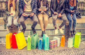 Young people with shopping bags