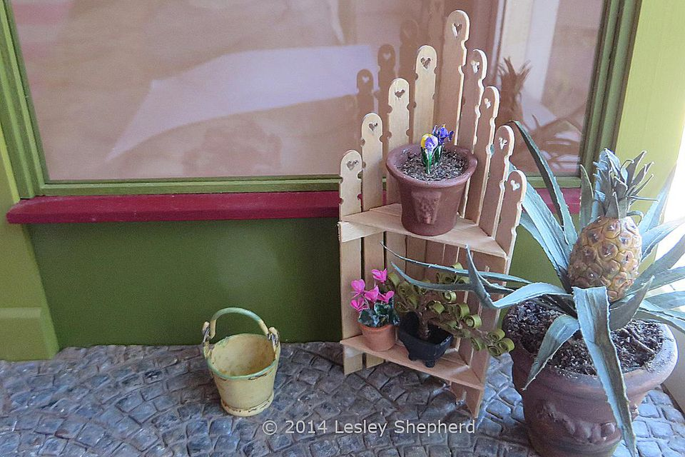 shabby chic plant shelves use stir sticks to make a miniature corner shelf unit