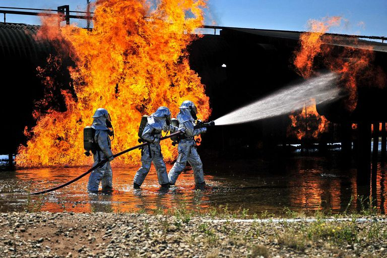 August 2, 2012 - Firefighters work to extinguish a simulated engine fire at Cannon Air Force Base, New Mexico.