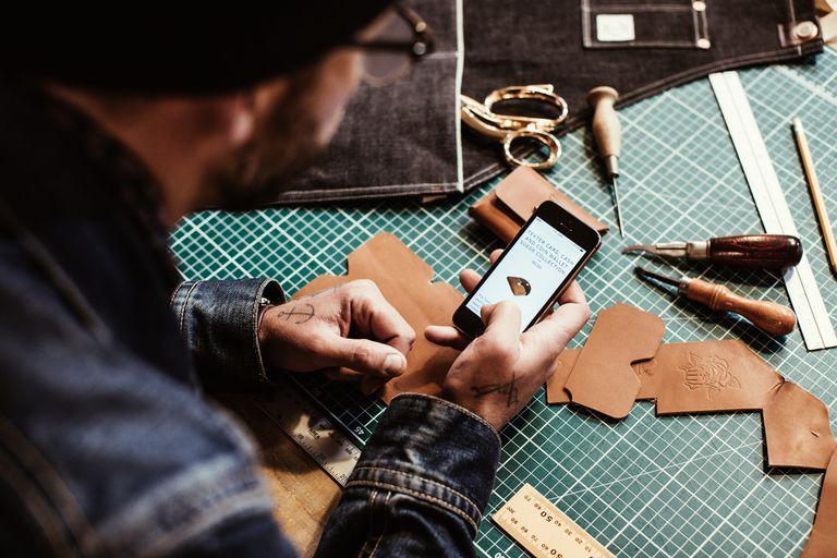 A craftsman checks his mobile website