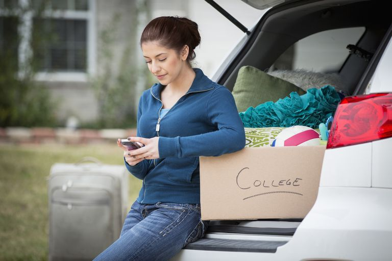 Hispanic girl packing for college