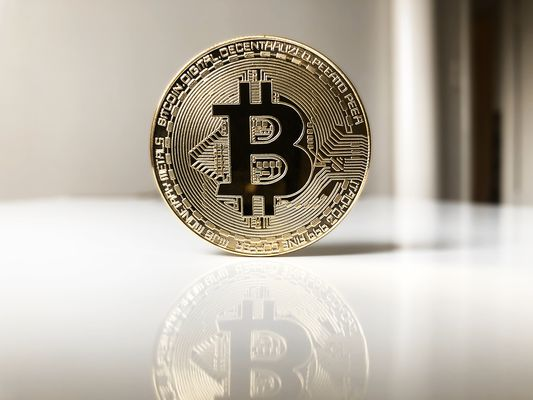 Close-Up Of Bitcoin On Desk