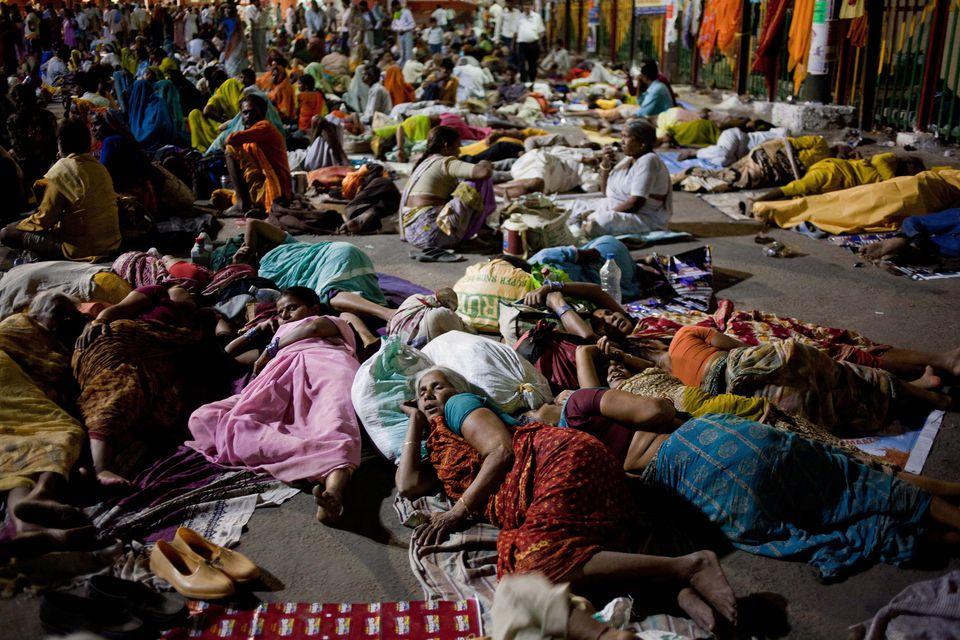 photo essay evocative pictures of the kumbh mela pilgrims sleep in close proximity at the kumbh mela