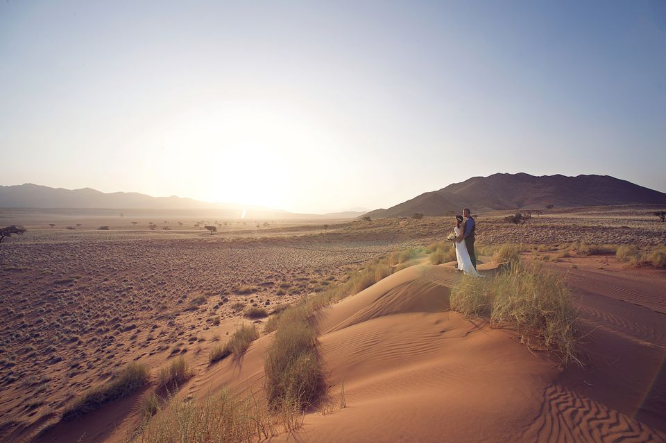 Africa sand dune wedding couple