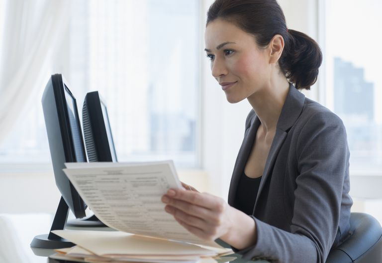 A woman reviews important business documents