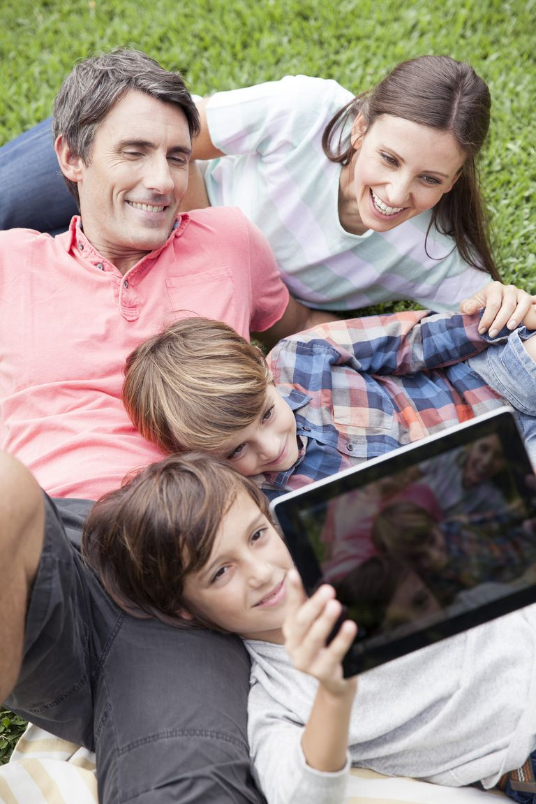 Family taking selfie with tablet