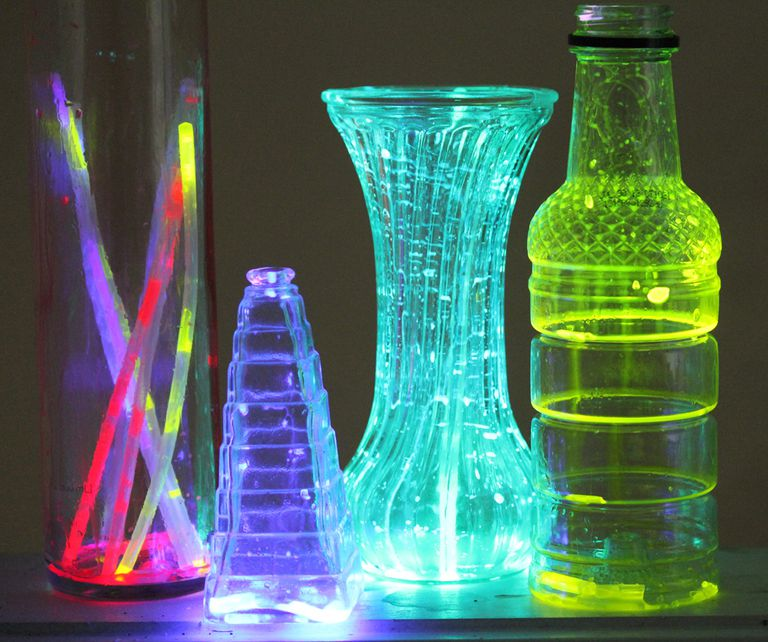 Shake liquid from glowsticks into translucent containers to make decorative lanterns.