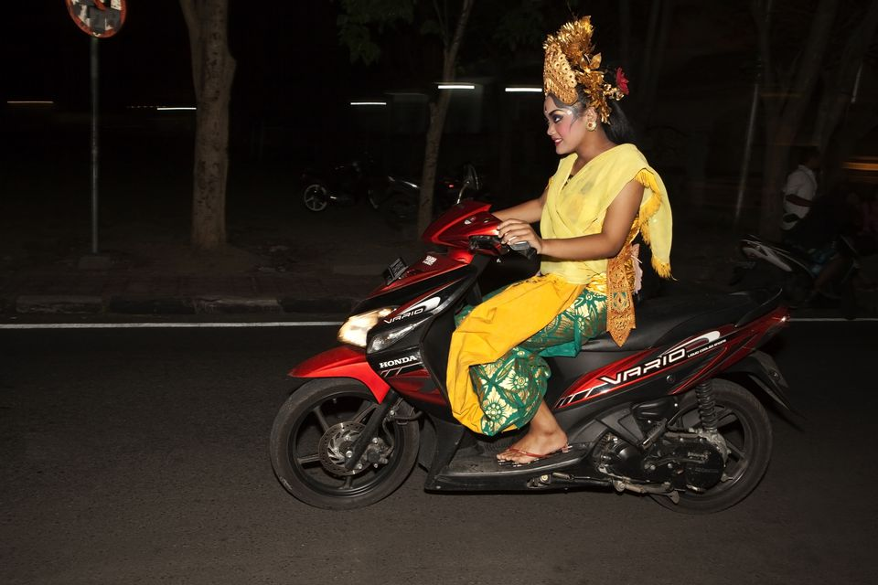 Dancer riding home to Ubud, Bali