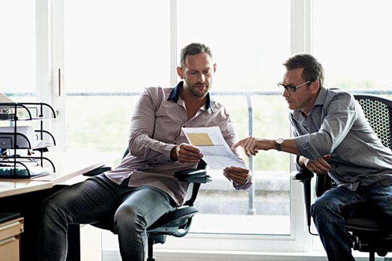 Business men discussing data