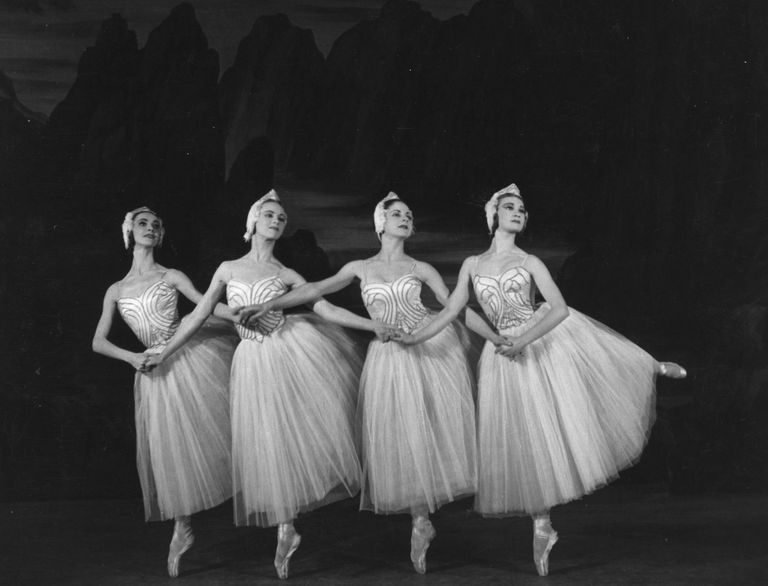 :circa 1950: Four cygnets dancing in a production of Swan Lake at Sadler's Wells Theatre, London.