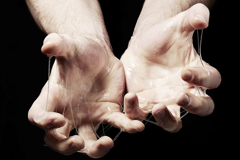 Mans hand with slime on black background