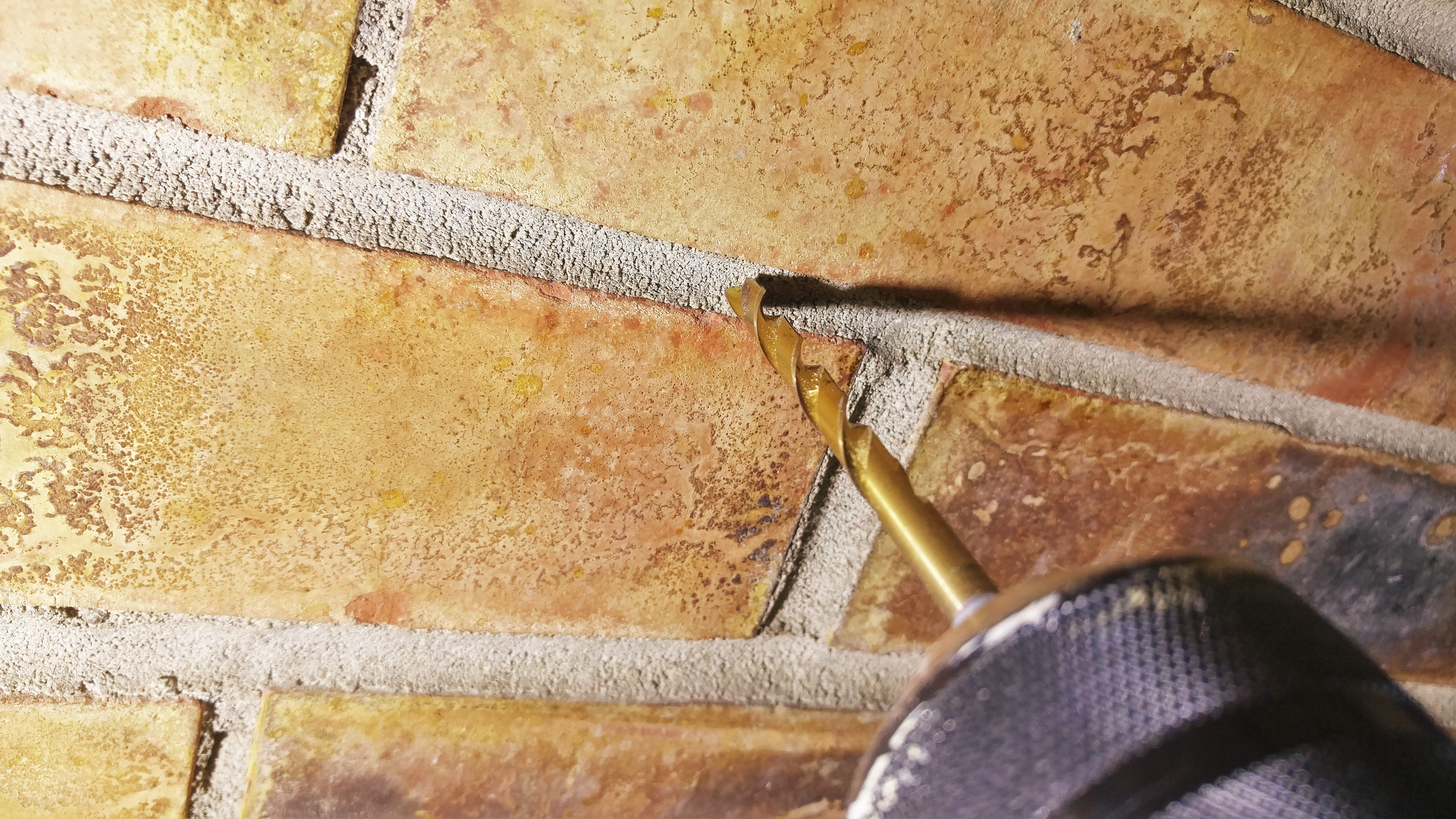 how to remove a brick from a wall