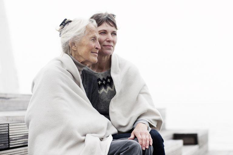 two generations women, wrapped in blanket
