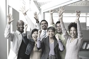 Multi-ethnic business people celebrating successful change management.