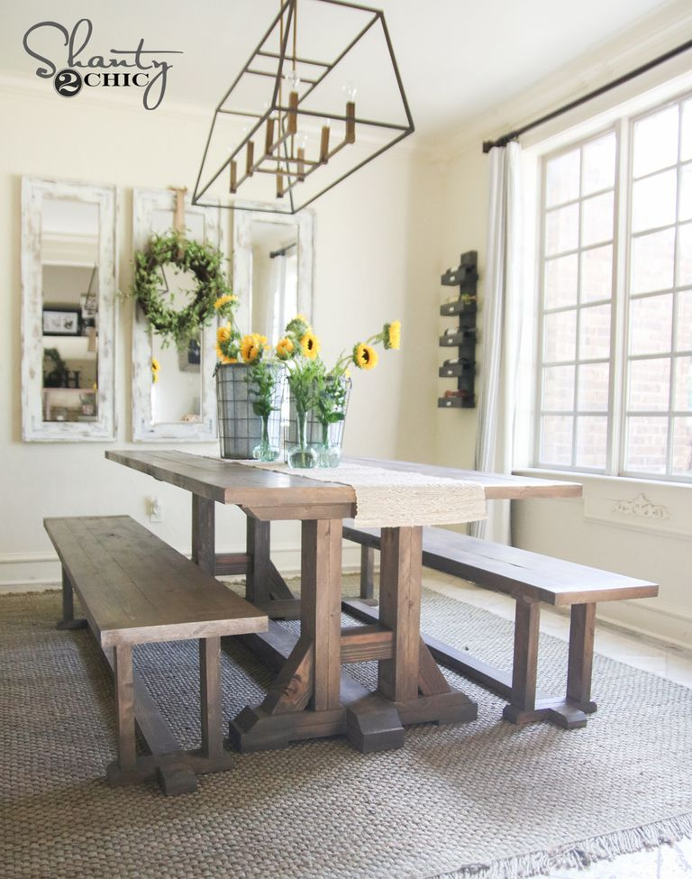 A Farmhouse Table With Benches In Dining Room