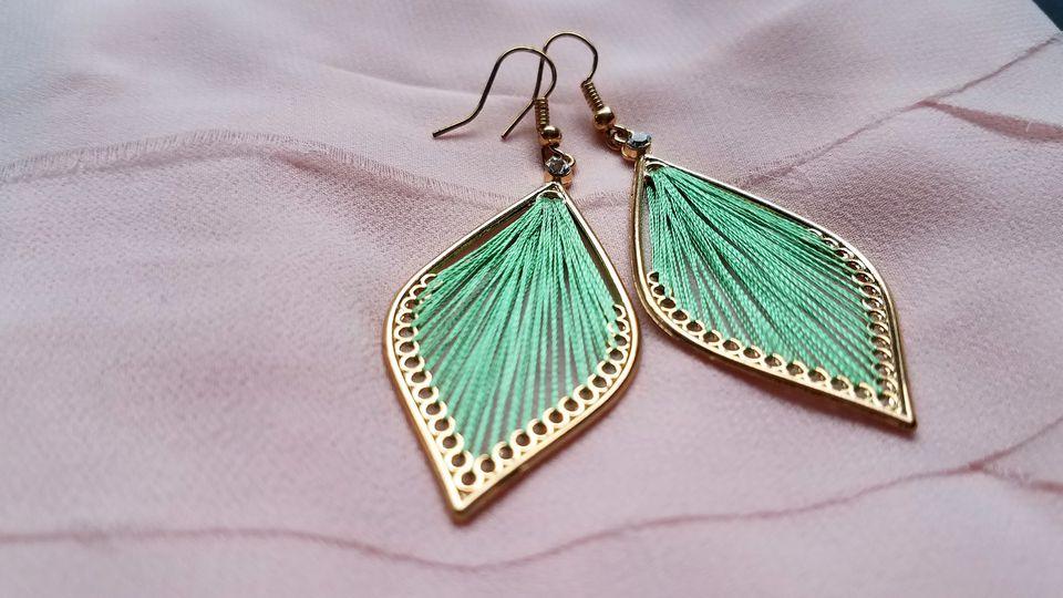 Pair of earrings on cloth