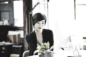 Businesswoman at desk on computer