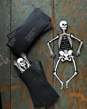 A Halloween invitation shaped like a skeleton.