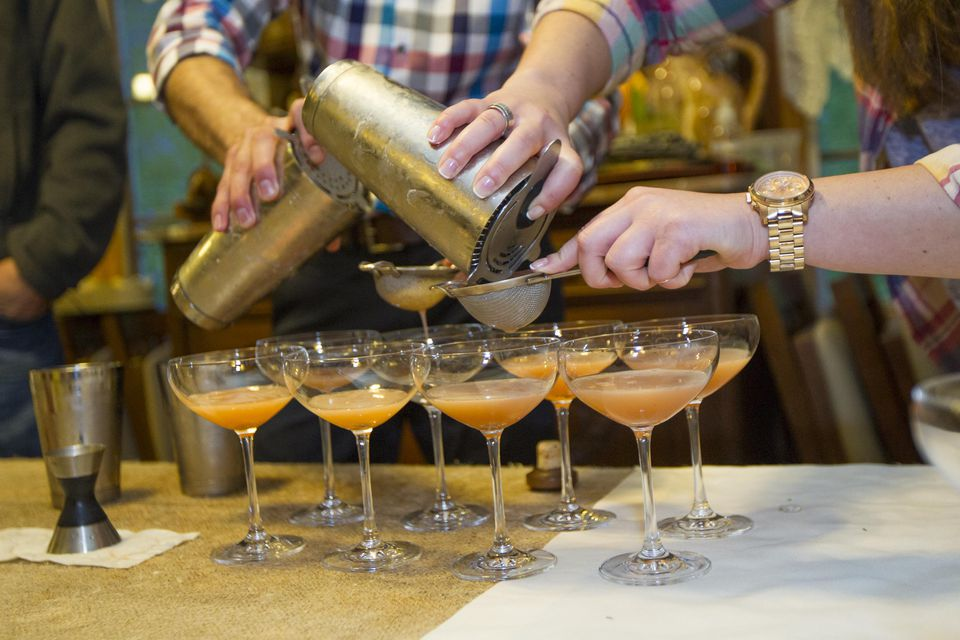 Mixologist Adam Reaume prepares drinks at the Bounty & Barrel