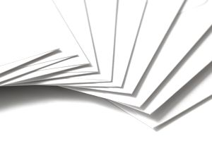 Isolated shot of stacked blank envelopes on white background