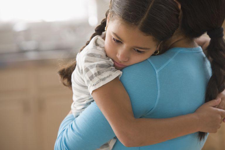 Mother comforting daughter