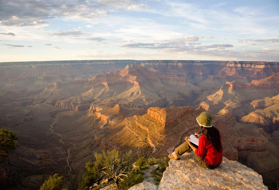 Writing in Diary at the Grand Canyon