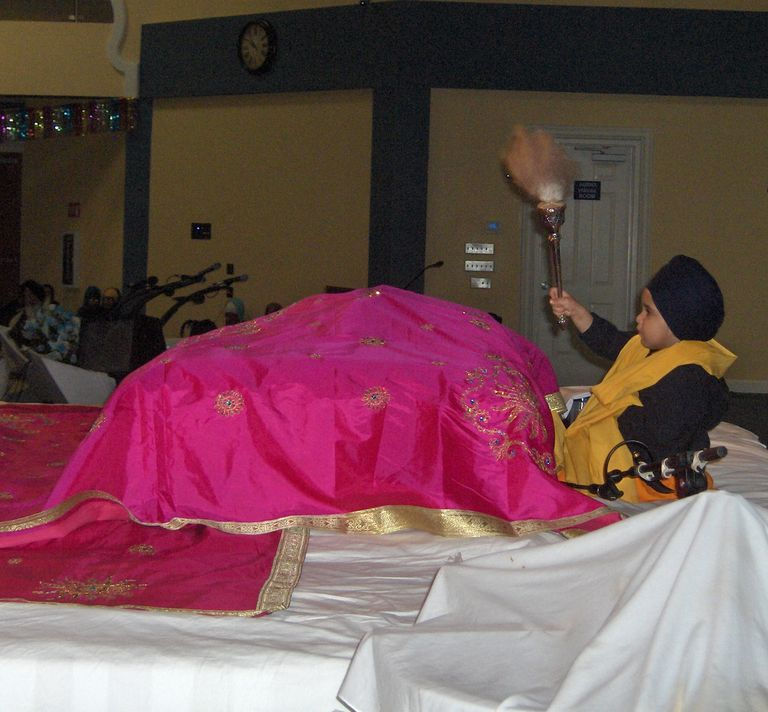 Sikh Boy Performing Chaur Whisk Seva