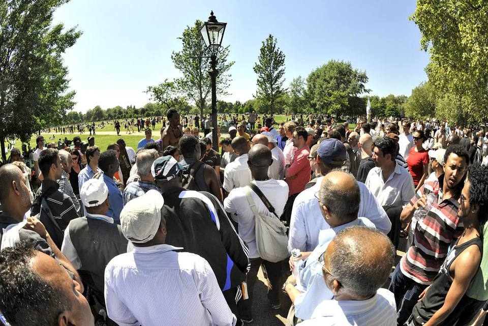 Crowds at Speakers corner in Hyde Park in London, UK