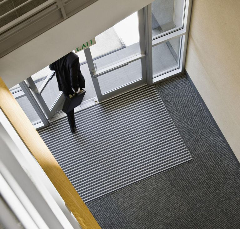 Businessman leaving office, low section, high angle view