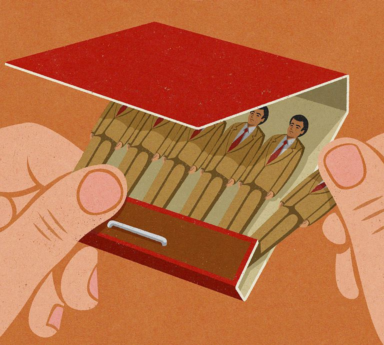 hand removing businessman from matchbook illustration - Getting Fired How To Avoid Getting Fired From Your Job
