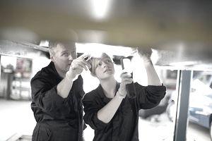 Trainee mechanic with boss
