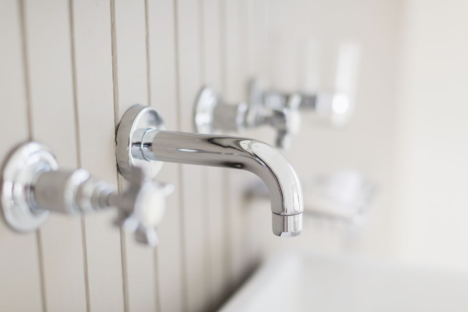 Close up modern stainless steel bathtub faucet