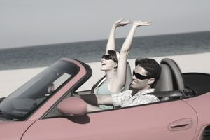 Couple enjoying a convertible ride