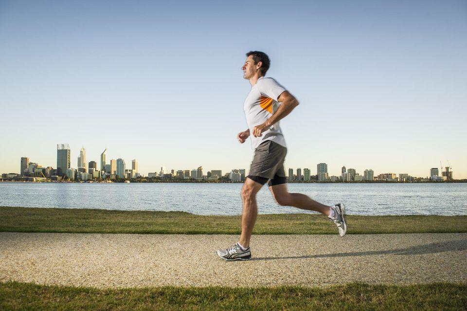 Mature male running on waterfront path, Perth, Australia