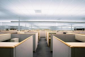 Empty office floor with cubicles