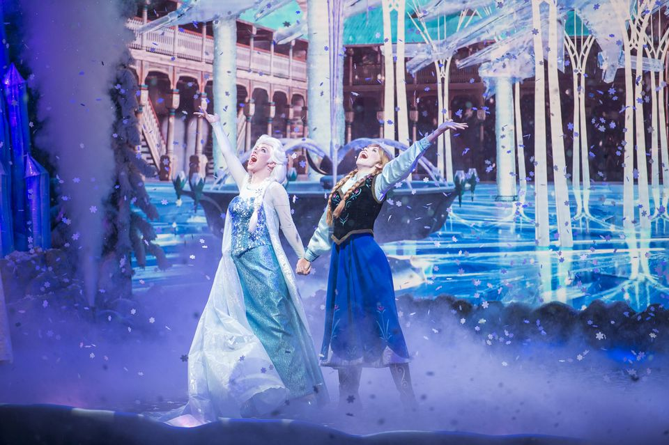 Anna and Elsa on stage at Disney's Hollywood Studios for Frozen Sing-Along Celebration.