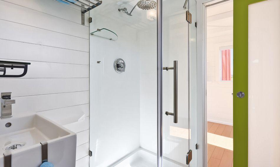 builder grade shower in tiny house bathroom