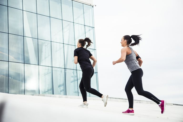 Women running uphill