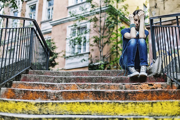 Sad Woman Sitting on Steps