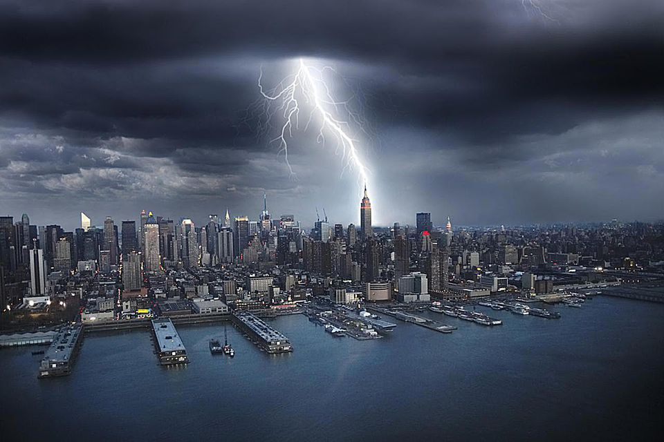 New York City, lightning striking Empire State building. Aerial view.