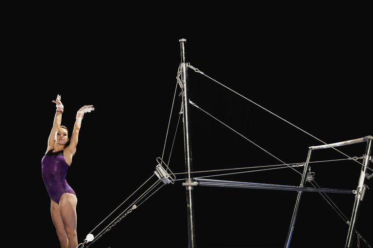 Gymnast Landing by Uneven Parallel Bars