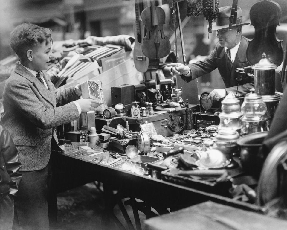 Vintage Photo of Boy Happily Shopping at Flea Market