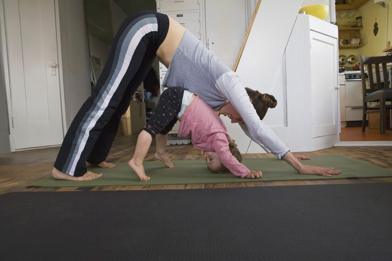 Woman and toddler doing yoga.