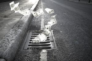 Money falling in a manhole
