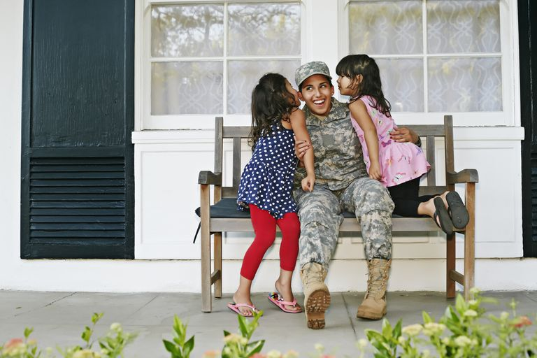 woman in military uniform with children