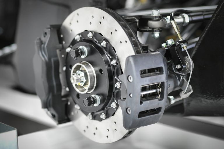 supercar brake system featuring dual fixed brake calipers